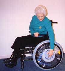 image of woman using power assist wheelchair